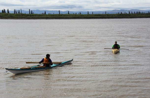 Two kayaks on the water near Aklavik.