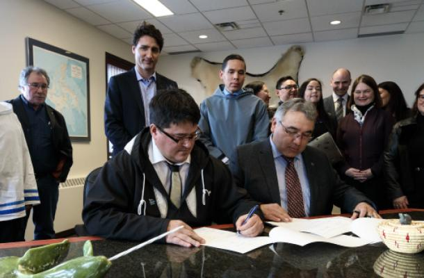 Duane Smith signs the Inuit-Crown Partnership declaration