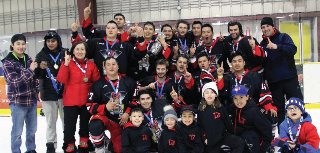 LJ's Contracting celebrates with the trophy at the IRC Native Hockey Tournament