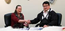 The Honourable Caroline Cochrane and Duane Smith during the signing ceremony.