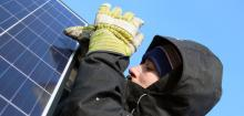 A participant installs the new PV system installed during ICEDO's Solar Energy Workshop
